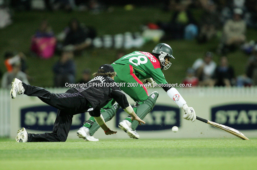Mehrab Hossain Jnr makes his ground as James Marshall fields the ball. New Zealand XI v Bangladeshis. Bangladesh Cyclone Relief Fund match. Seddon Park, Hamilton, New Zealand. Sunday 23 December 2007. Photo: Hagen Hopkins/PHOTOSPORT