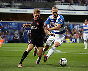Sebastian Polter battling with Tom Miller in a closely fought first half during the Capital One Cup match between Queens Park Rangers and Carlisle United at the Loftus Road Stadium, London, England on 25 August 2015. Photo by Matthew Redman.