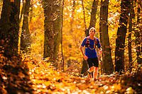 Man running and mountain biking in blue ridge mountains in fall color.