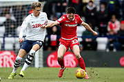 Nottingham Forest midfielder Joe Lolley (23) holds off Preston North End midfielder Brad Potts (44) during the EFL Sky Bet Championship match between Preston North End and Nottingham Forest at Deepdale, Preston, England on 16 February 2019.