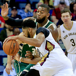 Nov 1, 2016; New Orleans, LA, USA; New Orleans Pelicans forward Anthony Davis (23) drives in against Milwaukee Bucks center Greg Monroe (15) during the first quarter of a game at the Smoothie King Center. Mandatory Credit: Derick E. Hingle-USA TODAY Sports