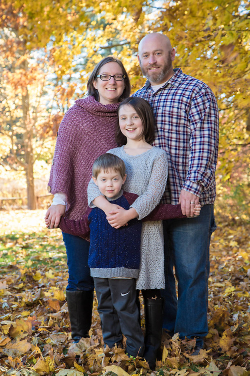 Fall photo session happy family under the fall colors.