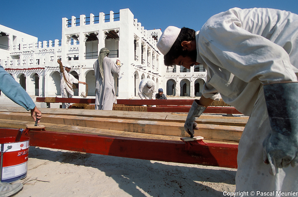 QATAR. Doha. Waqif souk. Foreign workers...To restore the old Waqif souk, the country brings in foreign labour who rebuilds the souk with traditional materials. Soon, the modern souk of gold will be destroyed to be rebuilt in the traditional way.