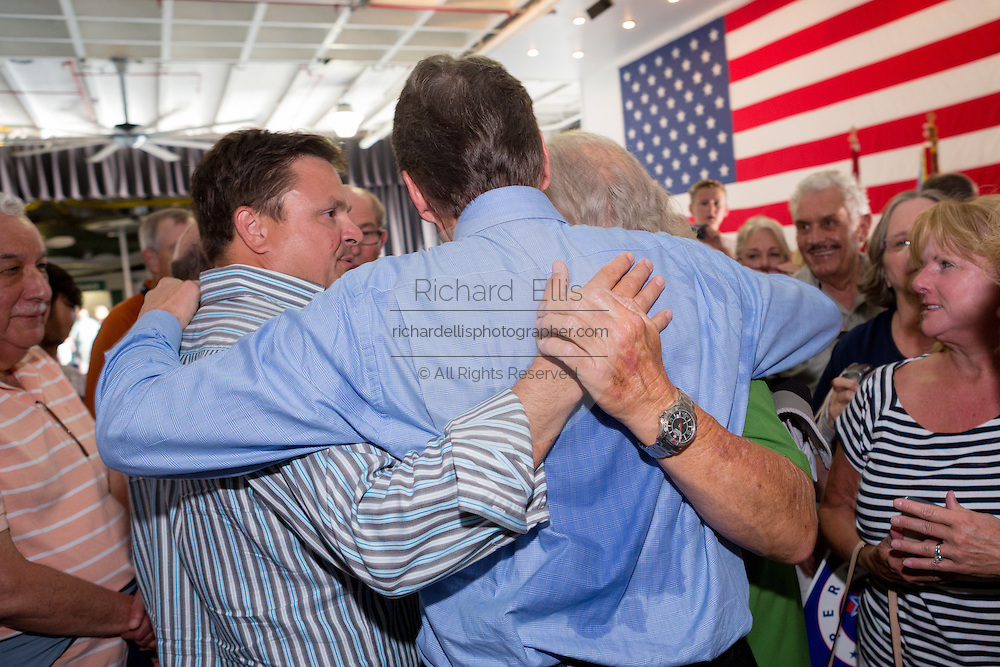 Former Texas Governor and GOP presidential hopeful Rick Perry greets supporters following a town hall event aboard the USS Yorktown in Mount Pleasant, South Carolina.