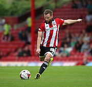 Alan Judge (Brentford midfielder) striking the ball from a Brentford free kick during the Sky Bet Championship match between Brentford and Reading at Griffin Park, London, England on 29 August 2015. Photo by Matthew Redman.