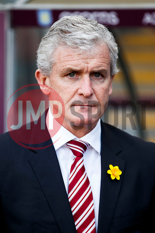 Stoke Manager Mark Hughes (WAL) looks on before kick off - Photo mandatory by-line: Rogan Thomson/JMP - 07966 386802 - 23/03/2014 - SPORT - FOOTBALL - Villa Park, Birmingham - Aston Villa v Stoke City - Barclays Premier League.