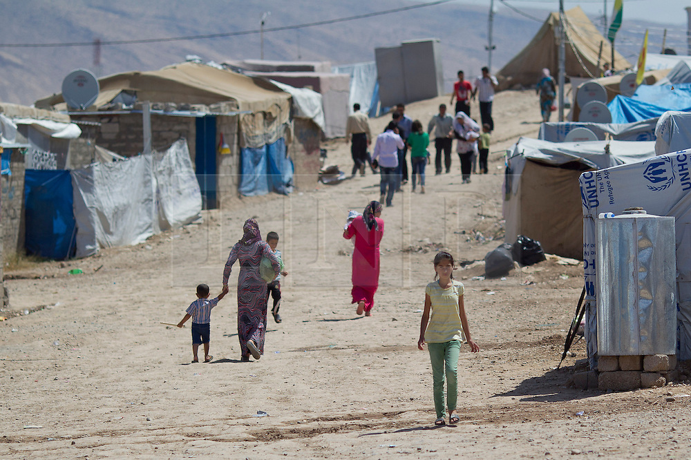 © Licensed to London News Pictures. 12/05/2013. Dohuk, Iraq. Syrian refugees are seen inside the Domiz refugee camp in Iraqi-Kurdistan, set up for those escaping the ongoing civil war in Syria. The camp, close to the city of Dohuk, now houses in the region of 45,000 refugees, with around 400 new arrivals every day. Photo credit: Matt Cetti-Roberts/LNP