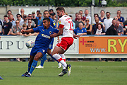 AFC Wimbledon striker Kweshi Appiah (9) battles for possession with Rotherham United defender Clark Robertson (15)during the EFL Sky Bet League 1 match between AFC Wimbledon and Rotherham United at the Cherry Red Records Stadium, Kingston, England on 3 August 2019.