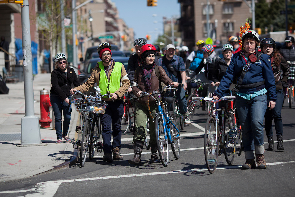 Families and friends of New Yorkers killed while bicycling on New York City streets ride in Brooklyn, NY, on Sunday, April 21, 2013 as they participate in the 8th Annual Ghost Bike Memorial Ride. The ride visited the 20 white-painted Ghost Bikes installed at the scene of bicyclist fatalities in five boroughs before converging at the intersection of Queens Boulevard and Jackson Avenue to dedicate a memorial to all of the cyclists who were killed in traffic crashes in 2012 whose deaths did not make the news...According to the New York City Department of Transportation, 136 pedestrians and 18 bicyclists were killed in 2012. In 2011, 134 pedestrians and 22 bicyclists were killed on New York City streets. To date, at least two bicyclists have been killed in 2013...Photograph by Andrew Hinderaker for the Ghost Bike Project.