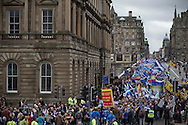 Crowds marching down North Bridge in Edinburgh during a pro-Independence march and rally in the Scottish capital. The event, which was staged in support of the pro-Independence movement, was attended by an estimated by approximately 30,000 people. The referendum to decide whether Scotland will become an independent nation will be staged on 18th September 2014.