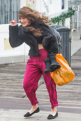 © Licensed to London News Pictures. 10/12/2017. Brighton, UK. Members of the public have problems keeping on their feet at Brighton and Hove is hit by powerful winds and rain, today 10th December 2017. Photo credit: Hugo Michiels/LNP