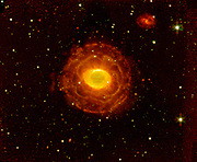The 'ring' is a thick cylinder of glowing gas and dust around the doomed star. As the star begins to run out of fuel, its core becomes smaller and hotter, boiling off its outer layers. Ring Nebula. Spitzer Space Telescope.
