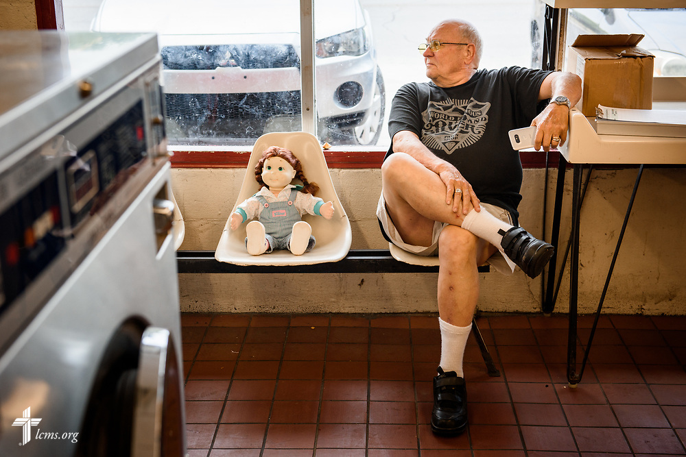 """Tom Pennington, a volunteer from St. Paul Lutheran Church, San Antonio, Texas, waits for guests at the Laundry Love event on Wednesday, Aug. 2, 2017, at the E-Z Wash laundromat in San Antonio. The monthly ministry event is supported by a grant through the """"Stand With Your Community"""" program, which was made possible by a partnership between the LCMS, Thrivent Financial and Lutheran Church Extension Fund. LCMS Communications/Erik M. Lunsford"""