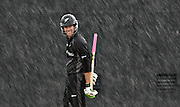 New Zealand's Jacob Oram walks off the pitch after a rainstorm interrupted play against Ireland during the World Cup of Cricket in Georgetown Guyana (2007)