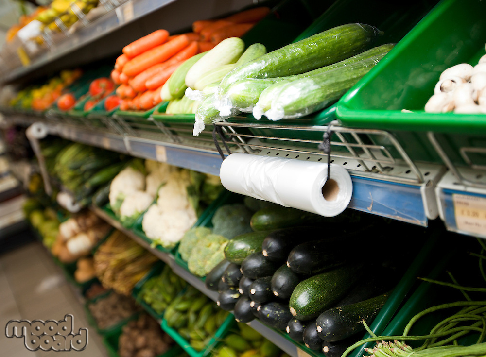 Variety of vegetables on shelves in grocery store