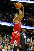 Apr 27, 2010; Cleveland, OH, USA; Chicago Bulls guard Derrick Rose (1) shoots a jumper as Cleveland Cavaliers head coach Mike Brown looks on during the third period in game five in the first round of the 2010 NBA playoffs at Quicken Loans Arena.  Mandatory Credit: Jason Miller-US PRESSWIRE
