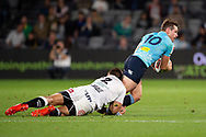 SYDNEY, AUSTRALIA - APRIL 27: Waratahs player Bernard Foley (10) tackled by Sharks player Andre Esterhuizen (12) at round 11 of Super Rugby between NSW Waratahs and Sharks on April 27, 2019 at Western Sydney Stadium in NSW, Australia. (Photo by Speed Media/Icon Sportswire)
