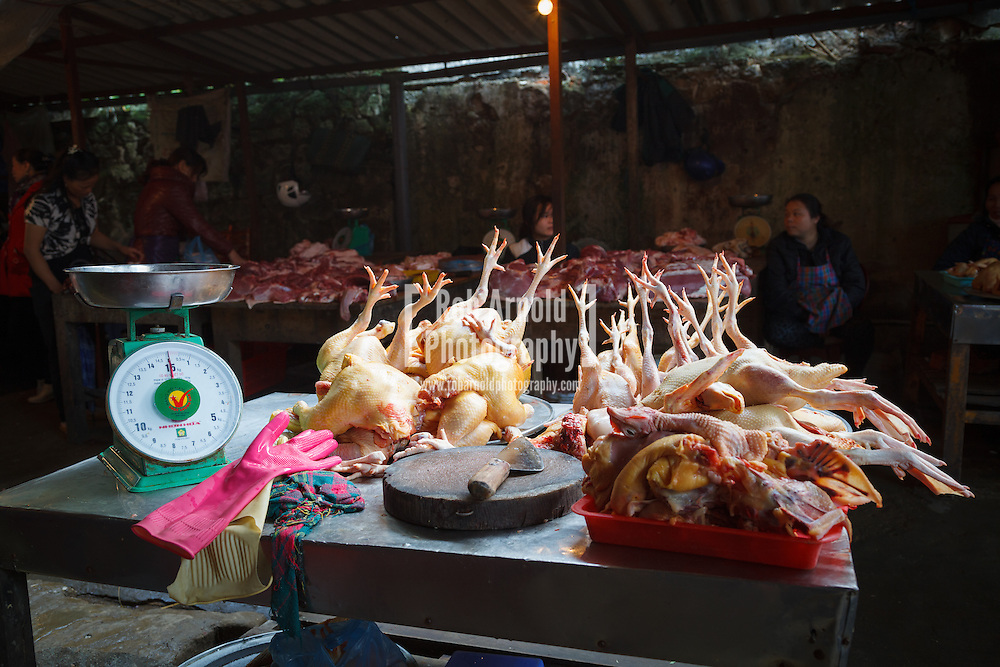 17/04/2013 - Sa Pa, Vietnam. Fresh chickens laid out on a table with their feet in the air at the market in Sa Pa, Northern Vietnam. Photo by Rob Arnold