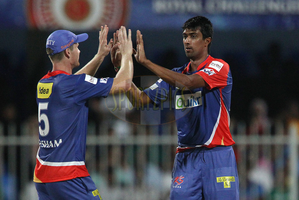 Rahul Sharma of the Delhi Daredevils celebrates the wicket of Parthiv Patel of the Royal Challengers Bangalore during match 2 of the Pepsi Indian Premier League Season 7 between the Delhi Daredevils and The Royal Challengers Bangalore held at the Sharjah Cricket Stadium, Sharjah, United Arab Emirates on the 17th April 2014<br /> <br /> Photo by Ron Gaunt / IPL / SPORTZPICS