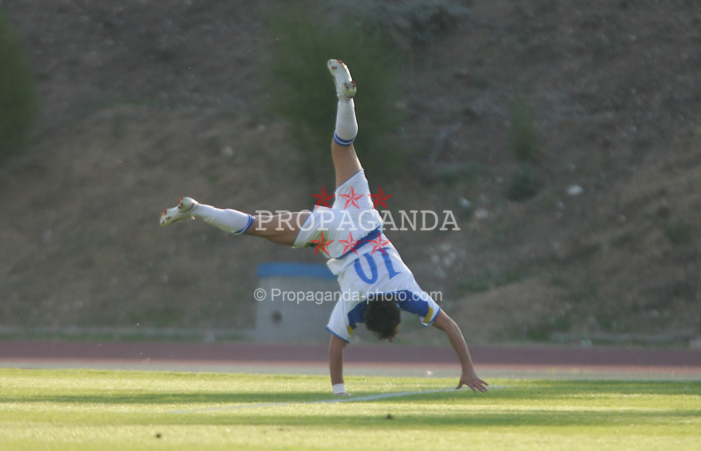 PAPHOS, CYPRUS - TUESDAY, NOVEMBER 15th, 2005: Cyprus' Kyriakos Pavlou celebrates scoring the first goal against Wales during the Under-21 International Friendly match at the Paphiako Stadium. (Pic by David Rawcliffe/Propaganda)