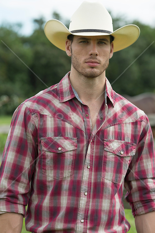 portrait of a good looking All American cowboy outdoors