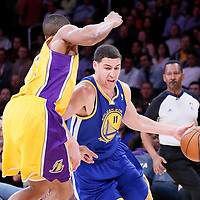 11 April 2014: Golden State Warriors guard Klay Thompson (11) drives past Los Angeles Lakers forward Wesley Johnson (11) during the Golden State Warriors 112-95 victory over the Los Angeles Lakers at the Staples Center, Los Angeles, California, USA.