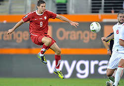 (L) Robert Lewandowski of Poland shoots on Georgia's goal during friendly soccer match between Poland and Georgia in Lubin, Poland...Poland, Lubin , August 10, 2011..( Photo by © MEDIASPORT )..PICTURE ALSO AVAIBLE IN RAW OR TIFF FORMAT ON SPECIAL REQUEST.