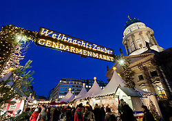 Night view of busy traditional German Christmas Market in Gendarmenmarkt in Mitte Berlin Germany