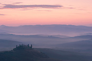 A dawn view over the misty hills of Val D'Orcia and the Belvedere.  San Quirico d'Orcia, Tuscany, Italy, Europe