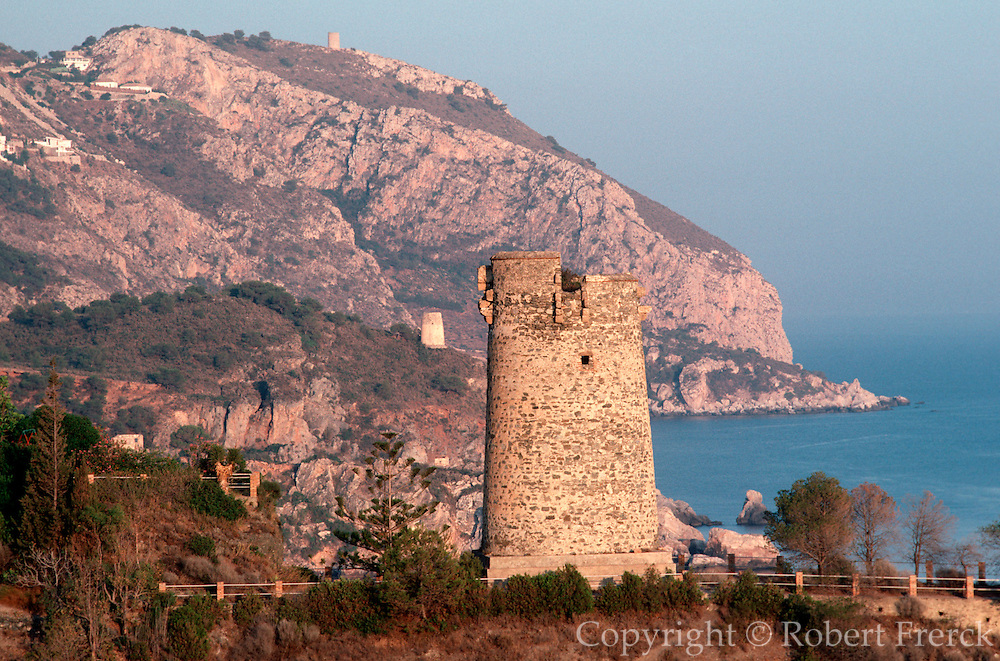 SPAIN, ANDALUSIA Costa del Sol, beach, cliffs, and watchtowers, east of Nerja