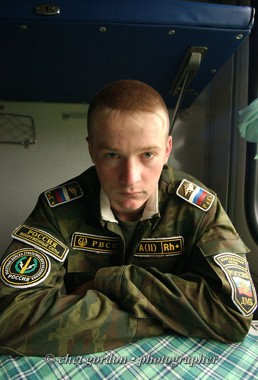 Russian soldier in the Third Class railway car of a Moscow-to-Tomsk bound Trans Siberian Railway route outside Omsk, Siberia Russian Federation on June 11, 2005.