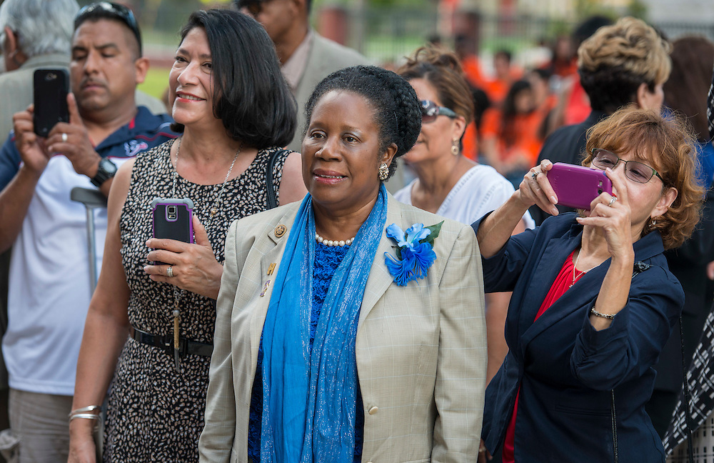 Representative Shelia Jackson Lee watches a ceremony to rename Jackson Middle School to Navarro Middle School in honor of Yolanda Black Navarro, October 5, 2016.
