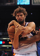 Oct. 22 2010; Phoenix, AZ, USA; Phoenix Suns forward-center Robin Lopez (15) fights for the ball against the Denver Nuggets during a preseason game at the US Airways Center. The Nuggets defeated the Suns 144 - 106. Mandatory Credit: Jennifer Stewart-US PRESSWIRE.