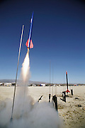 Amateur rocket launch. Launch of a rocket during the annual Black Rock X amateur rocketry event in the Black Rock desert, Nevada, USA. This huge flat expanse of land is a popular launch site for large and powerful amateur rockets as it is far from civilization and has little natural animal or plant life.