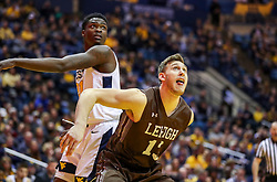 Dec 30, 2018; Morgantown, WV, USA; Lehigh Mountain Hawks center James Karnik (13) boxes out to rebound during the second half against the West Virginia Mountaineers at WVU Coliseum. Mandatory Credit: Ben Queen-USA TODAY Sports