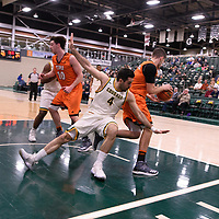 5th year guard Alex Igual (4) of the Regina Cougars in action during the Men's Basketball Play-In game on February  8 at Centre for Kinesiology, Health and Sport. Credit: Arthur Ward/Arthur Images