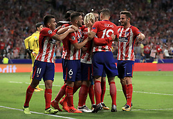 Atletico Madrid's Antoine Griezmann is mobbed by his team-mates after scoring his side's first goal