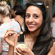 Armana Rai is a fitness blogger tasting a Sicilian Lemon Cheesecakes, served with Skinny Prosecco at Farm Girls Café, 1 Carnaby Street, Soho, London, UK on July 18 2018.