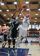 November 28, 2011; Moraga, CA, USA; Saint Mary's Gaels forward Kenton Walker II (30, left) blocks the shot of Weber State Wildcats forward Darin Mahoney (30, right) during the first half of the Shamrock Office Solutions Classic championship game at McKeon Pavilion.