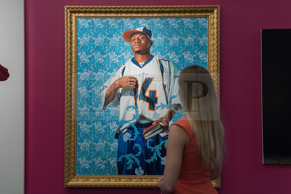 "© Licensed to London News Pictures. 08/09/2017. London, UK. A staff member views ""St. Francis"", 2007, by Kehinde Wiley (Est. GBP30-40k), at a preview of 'Shake It Up', a collection of contemporary artworks from the personal collection of celebrity photographer Mario Testino. Proceeds from the upcoming auction of the collection at Sotheby's in London will benefit Museo Mate in Lima, Peru.  Photo credit : Stephen Chung/LNP"