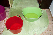 Rain water is collected in buckets and pails as it leaks through the ceiling