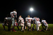 Trimble High School football players huddle on the sideline during the game against South Gallia High School.