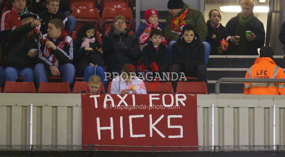 """LIVERPOOL, ENGLAND - Monday, January 21, 2008: Liverpool supporters protest against the club's American owners with a banner reading """"Taxi for Hicks"""" during the Premiership match at Anfield. (Photo by David Rawcliffe/Propaganda)"""