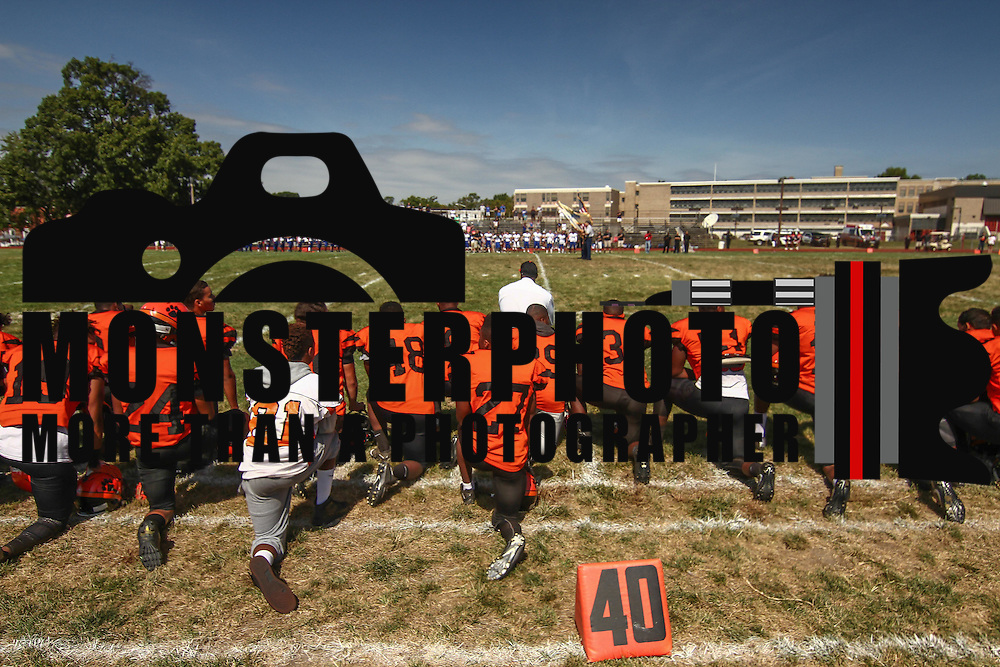 Tigers head coach Preston Brown and his players take a knee during the playing of the national anthem prior to a non-conference game between The Woodrow Wilson Tigers and The Northern Burlington Greyhounds Saturday, Sept. 17, 2016, at Mike Rozier Stadium in Camden, NJ.<br /> <br /> Preston Brown, told his players he would be doing so in order to highlight issues of social injustice in Camden.
