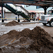 June 14, 2009 - Bronx, NY : Construction crews and emergency workers work to clean up and restore services to the intersection of Broadway and W. 231st St. where a water main broke overnight, leaving much of the community without water, and much of the neighborhood under water.