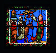 Flight into Egypt, detail from the stained glass window depicting the Childhood of Christ, made in the 19th century during restoration work by Viollet-le-Duc, in the Chapelle de la Vierge in the Basilique Saint-Denis, Paris, France. The original windows were destroyed during the French Revolution. The basilica is a large medieval 12th century Gothic abbey church and burial site of French kings from 10th - 18th centuries. Picture by Manuel Cohen
