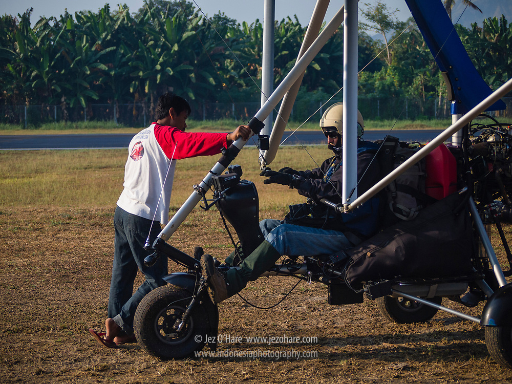 Sutiyono & Jez O'Hare preparing for take off at Ende airport, Flores, Nusa Tenggara Timur, Indonesia.