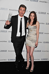 GARRETT HEDLAND and KRISTEN STEWART at the Glamour Women of The Year Awards 2011 held in Berkeley Square, London W1 on 7th June 2011.