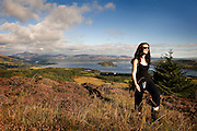woman walking with view of loch lomond in background 2
