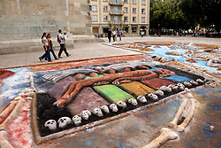 "North America, Mexico, Oaxaca Province, Oaxaca, sand tapestries (Tapetes de Areña) in Zocalo plaza.   These  ""carpets""  are made from sand, dyed sawdust, seeds, flower petals and powdered lime during annual Day of the Dead (Dias de los Muertos) celebration in November"